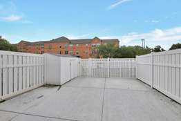 Newer Patio with Vinyl Privacy Fencing and Outdoor Storage