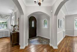 Entry Foyer with Arched Doorways