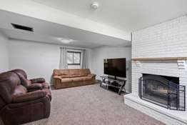 Rec Room with Wood Burning Fireplace