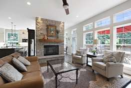 Stone Fireplace and Wall of Windows