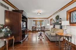 Leaded Glass Windows with Robust Wood Trim and Crown Molding