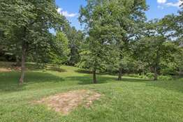 Enjoy the Privacy of the Wooded Backdrop of the Large Backyard