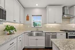 Newer White Cabinetry, Tiled Backsplash, and Newer Stainless Steel Appliances