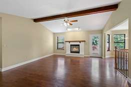 Vaulted Family Room with Wood Burning Fireplace