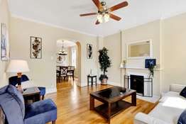 Living Room with Crown Molding, and Decorative Fireplace