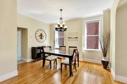 Formal Dining Room Features Crown Molding