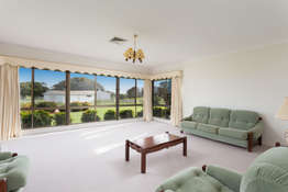 The formal living room with lovely rural views and beautiful sunsets