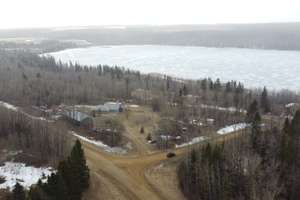 Gorgeous walkout bungalow on 3.51 acres with lake views