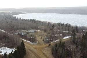 Gorgeous walkout bungalow on 3.51 acres with lake views