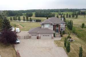 Gorgeous, 2 storey custom home on a golf course in Leduc County