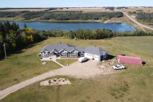 Custom built walkout bungalow on 15.17 acres in Leduc County