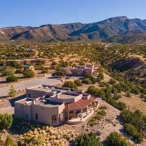 Views for MILES! Sandia Mountain, Western Mesa, Cabezon Peak, Jemez Mountains!
