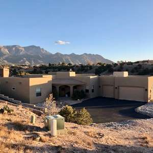 Single level - no steps! - with amazing Sandia Mountain views!