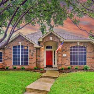 UNBELIEVABLE REMODEL in Coveted Stewart Peninsula of The Colony located in Cul-de-sac + only 1 block to Lake Lewisville and 5 minute walk to the Private Adult Infinity Pool.