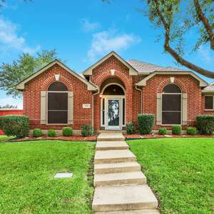 Well Maintained Brick House on a Corner Lot with Mature Trees, in Coveted Stewart Peninsula of The Colony located in Cul-de-sac + only 1 block to Lake Lewisville and 5 minute walk to the Adult Pool
