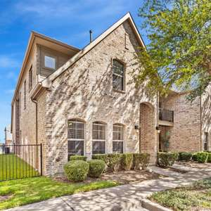 UPDATED ALL BRICK TOWNHOME WITH FENCED YARD IN COVETED BELLA CASA NEIGHBORHOOD OF FRISCO.