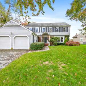 Classic Colonial in one of areas Most Sought After Neighborhoods