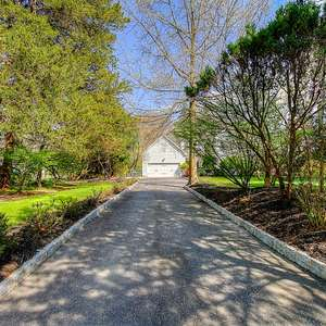 Tranquility abounds in this Shore Colonial in Wall. Spend your summer relaxing in the backyard featuring a deck, patio, natural woods & a gentle creek.