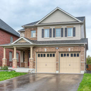 "Stunning ""Tribute Built"" Executive Home Located on a Ravine Lot In Highly Sought After Windfield Farms Community"