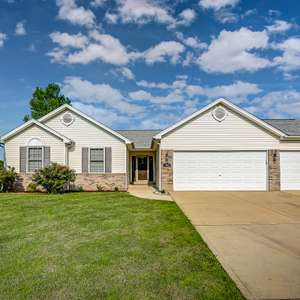 Modern Ranch on a Corner Lot with Quick Access to St. Louis