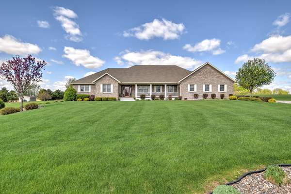 Like-new dream home on three quiet acres bordering town and country!