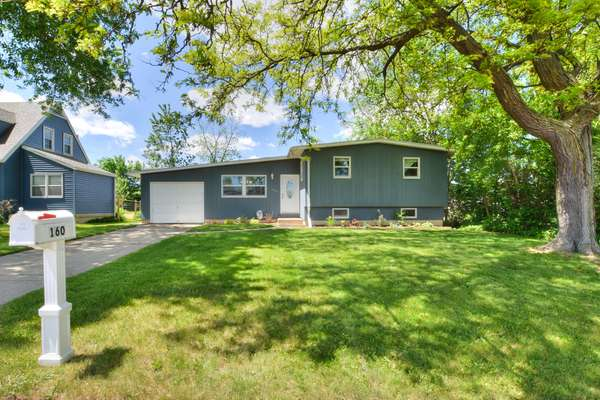 Updated Tri-Level Contemporary near Sun Prairie Schools and revitalized downtown!