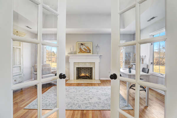 FRENCH DOORS FROM MASTER OPEN TO SITTING RM