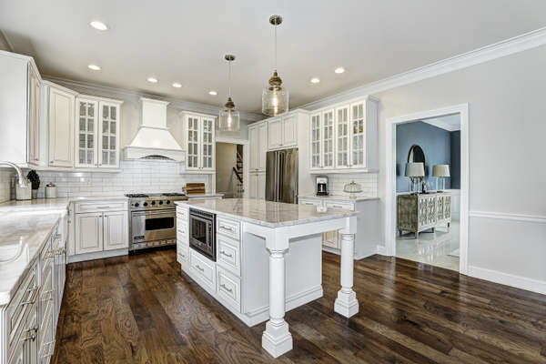 KITCHEN LEADS TO PANTRY, GARAGE, MUD ROOM, BACK STAIRS AND LAUNDRY ROOM