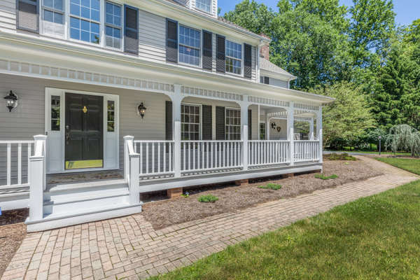 WRAP AROUND FRONT PORCH WITH SWING