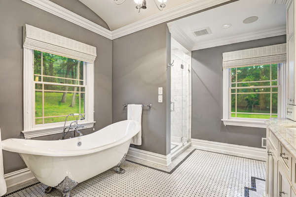 MASTER BATH WITH THE STUNNING QUALITY FINISHES AND RADIANT HEATED FLOOR