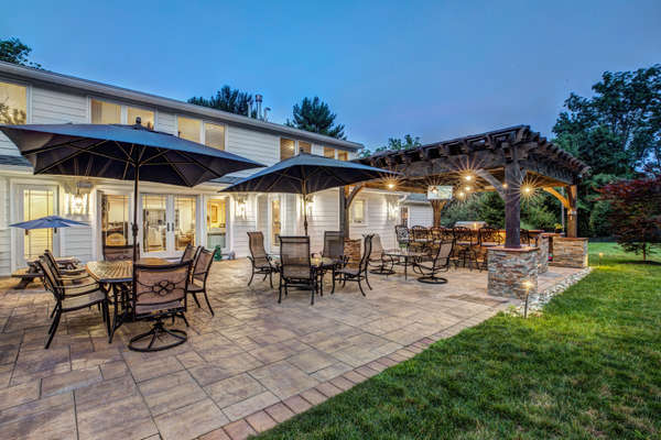 AN EXPANSIVE PATIO AND FULLY EQUIPPED OUTDOOR KITCHEN.