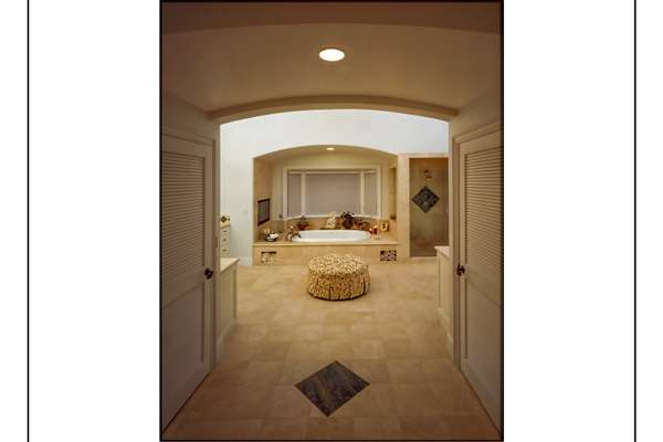 Master Bathroom with His and Hers Commodes.