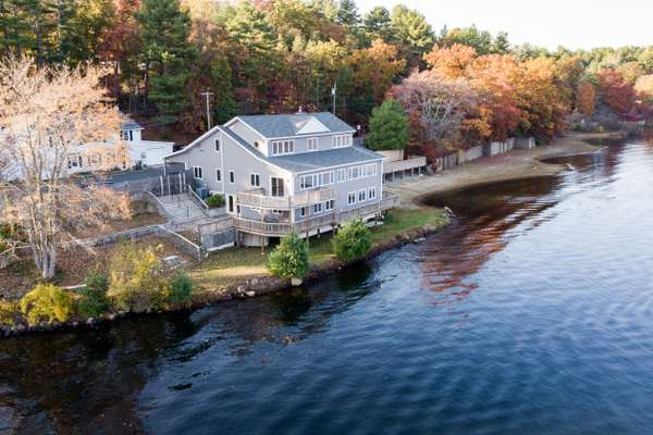 ULTIMATE YEAR-ROUND LIVING ON CRYSTAL LAKE - OVER 1,500FT OF FRONTAGE + PRIVATE BEACH!