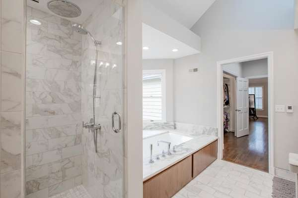 Shower with Tile Surround; Separate Soaking Tub with Marble Surround