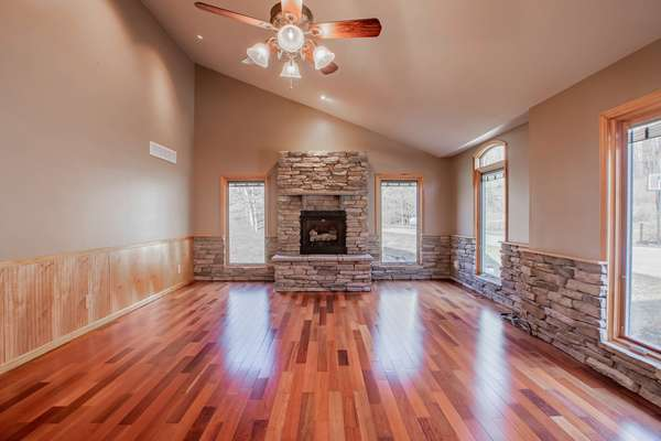 Large Den with a Cozy Gas Fireplace