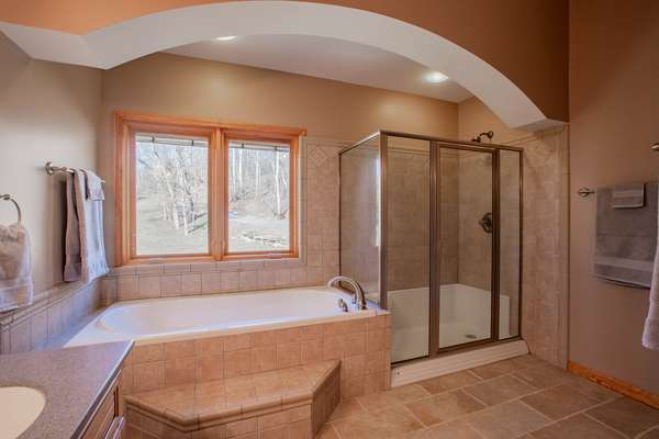 Soaking Tub and Separate Glass Shower