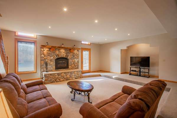 Large Rec Room with a Cozy Wood Burning Fireplace