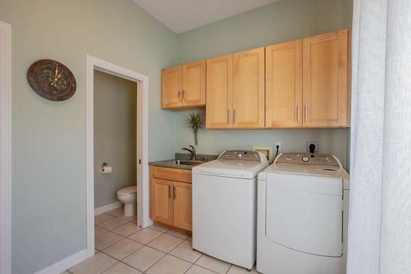 Main Floor Laundry Room with 2nd Powder Room