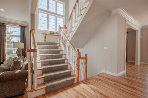 Walk up the grand, center staircase with a landing and an incredible wall of windows, bringing the outside in!