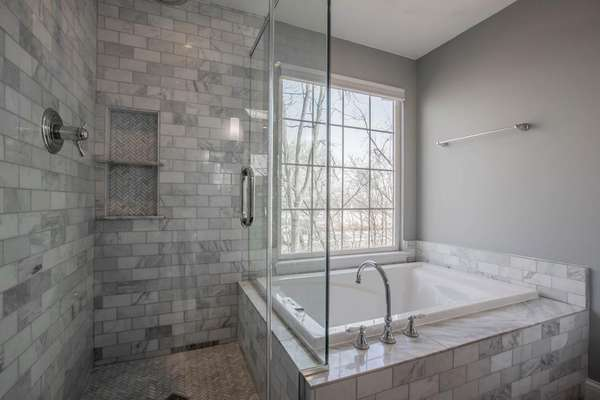 Soaking Tub & Seamless Shower with Stunning Tile Work