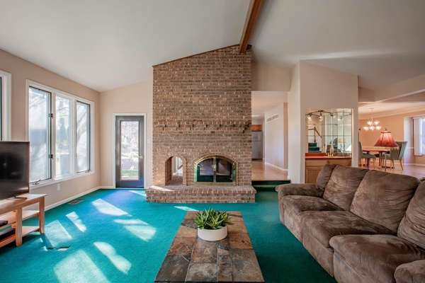 Floor-to-Ceiling, See-Through Brick Fireplace