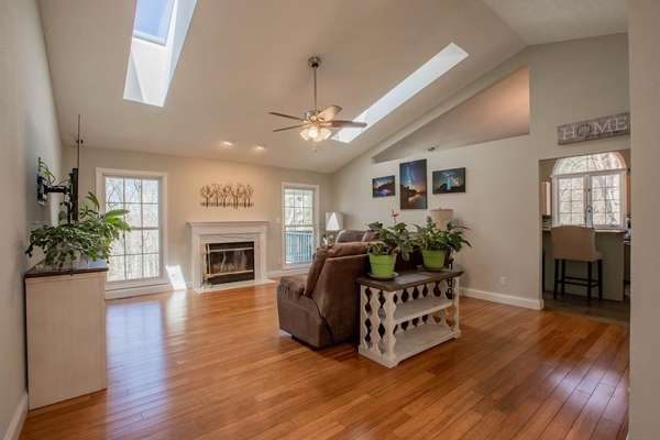 Spacious Great Room filled with natural lighting from the skylights and expansive vaults!