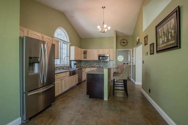 Custom Cabinetry, Quartz Countertops, Breakfast Bar, and Stainless Steel Appliances!