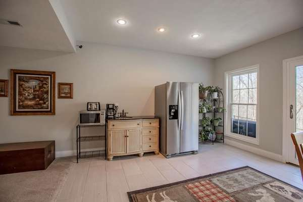 In-law Suite complete with a Sleeping Room, Accessible Shower, Refrigerator and Sink!