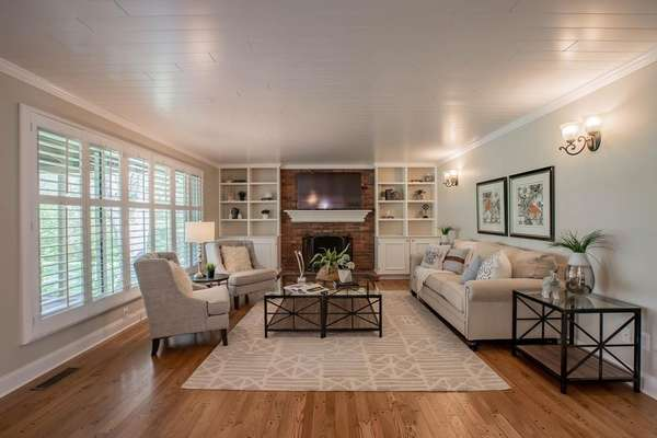 Family Room Offers Built-in Bookshelves, a Gas Fireplace, and Crown Molding