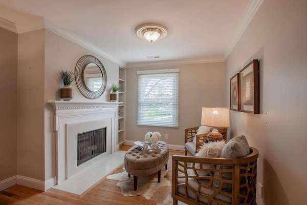 Master Suite Sitting Area with a Cozy Fireplace