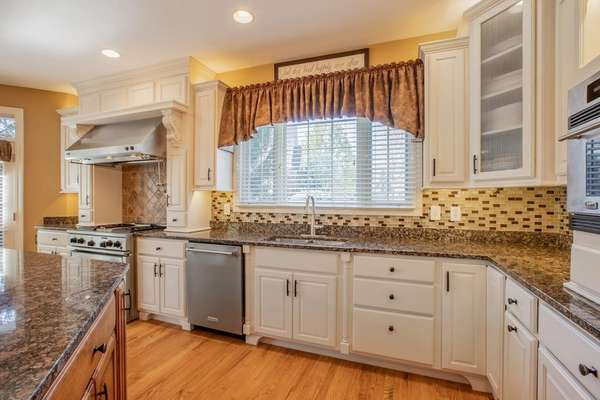 Granite Countertops, Custom 42 Inch Cabinetry with Crown Molding
