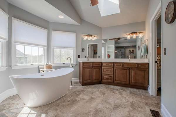 Master Bath with Freestanding Soaking Tub and Dual Vanities