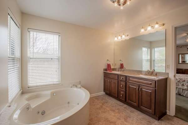 Master Bath with a Soaking Tub and a Dual Sink Vanity