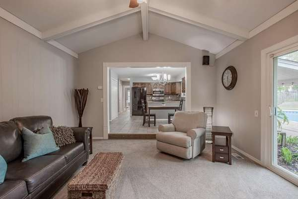 Vaulted Family Room with Wood Beam
